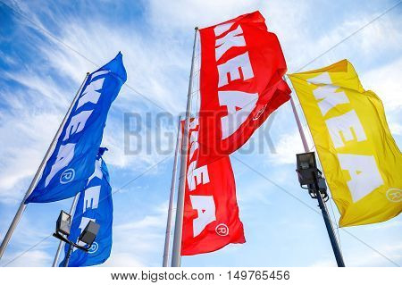 SAMARA RUSSIA - SEPTEMBER 25 2016: IKEA flags against a blue sky near the IKEA Samara Store. IKEA is the world's largest furniture retailer