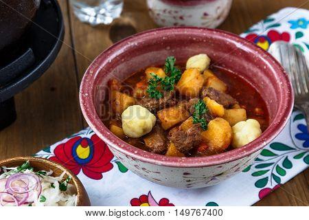 Bograch-goulash In Ceramic Plate. Traditional Hungarian Meal.