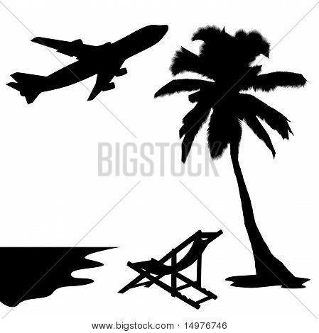Silhouette of palm, sunbed and plane