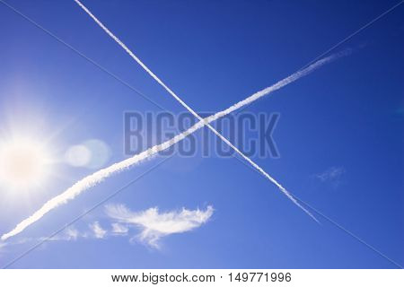 Reticle planes in the sky leaving a white trail bright Sunny day
