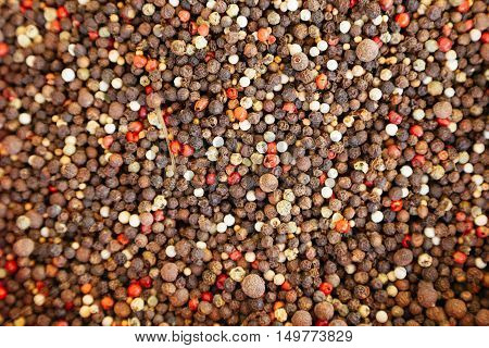 Colored dry peppers spice mix as background. Health food concept
