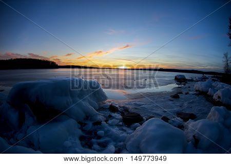 fishy landscape of a frozen lake at sunset