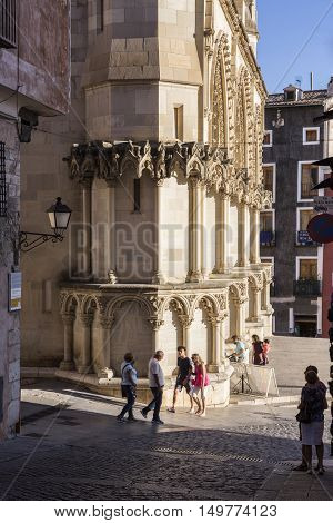 CUENCA SPAIN - August 24 2016: Tourists walk near the facade of the Cuenca's Cathedral The cathedral is dedicated to St Julian gothic english-norman style XII century called the Basilica of Our Lady of Grace take in Cuenca Spain
