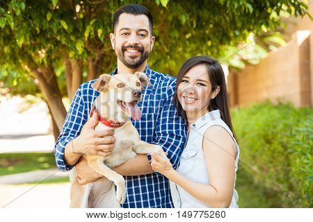 Beautiful Couple With A Dog