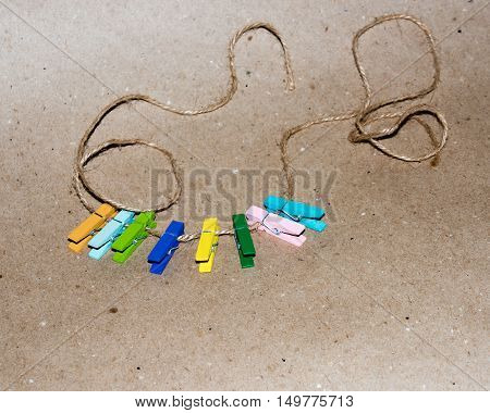 Colorful wooden clothespin. Background of colorful clothes pegs. Closeup of colorful clothespins.
