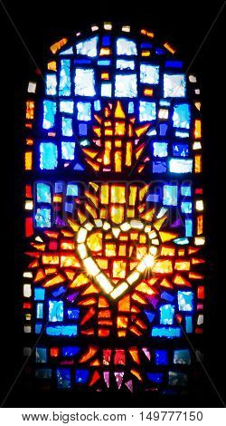 Paray Le Monial France - September 13 2016: Stained glass in the chapel of the heart in which God has revealed to Margaret Alacoque in Paray Le Monial France