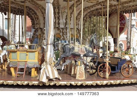 foreground detail of horses of a carousel