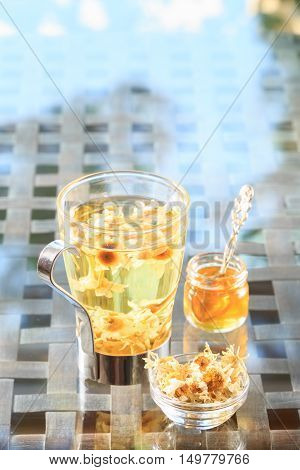 Concept Of Herbal Tea. Camomile Tea In A Glass Mug With Honey. Healthy Caffein-free Drink.