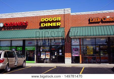 PLAINFIELD, ILLINOIS / UNITED STATES - SEPTEMBER 19, 2016: The Doggie Diner offers milk shakes, hot dogs and gyros, in a Plainfield strip mall.