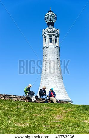 Mount Greylock, Massachusetts, USA - May 22, 2014: Hikers are taking a rest at the Memorial Tower