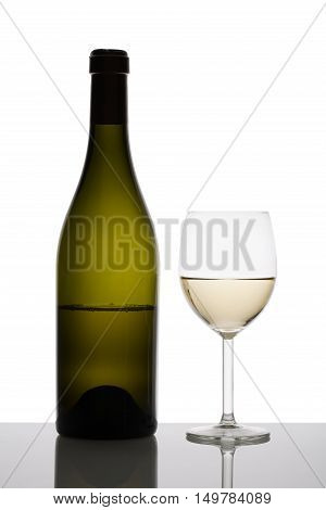 White wine glass and bottle of wine