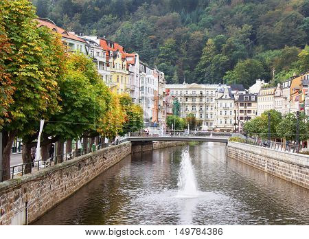 Tepla riverhomes and autumn trees in Karlovy Vary (Karlsbad) Czech Republic.