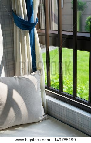 resting area of a cozy window seat with cushion in the morning