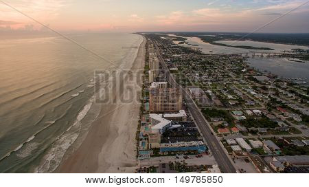 Aerial view of sunrise in Florida showing beach, rivers and bridges