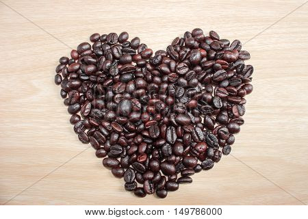 Coffee on grunge wooden background / Coffe heart on old wooden background