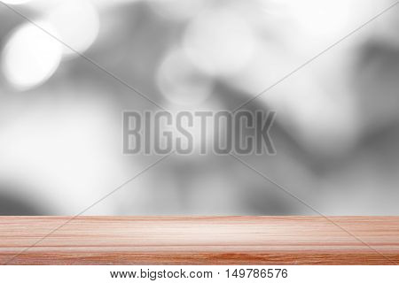 Empty wood table with backdrop white blurred nature background, Can be used for display your product