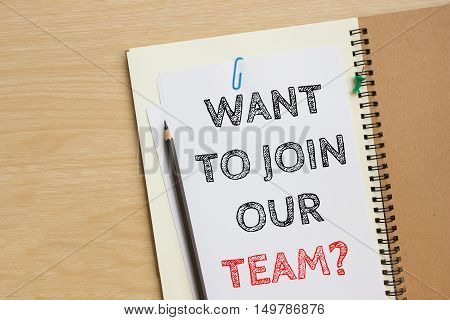 Text want to join our team on white paper and pencil / business concept