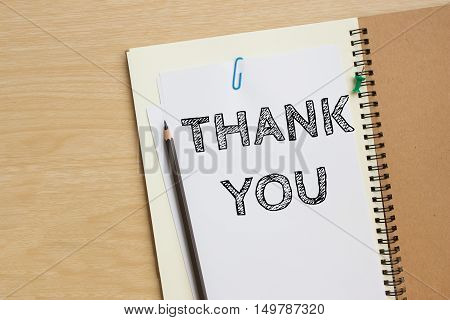 Text Thank you on white paper and pencil / business concept