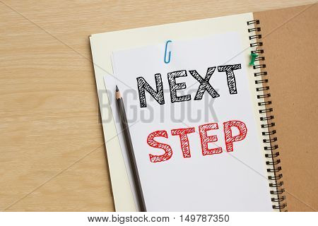 next step text message on white paper note on the desk / business concept