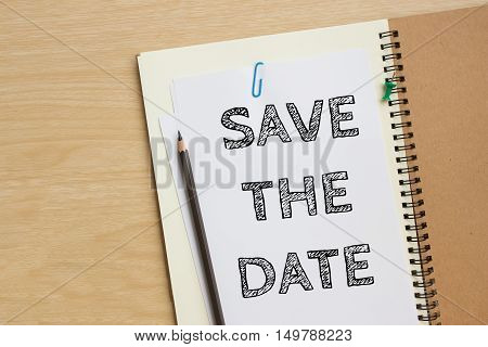 Save the date, text on white paper / business concept