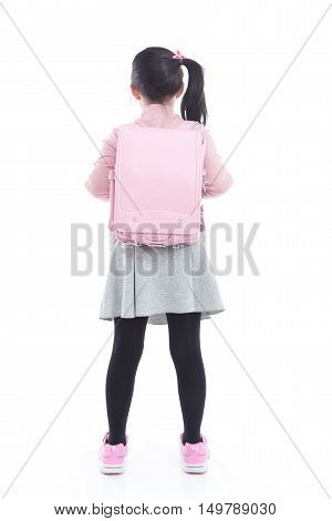 Back of Asian schoolgirl with pink school bag on white background isolated