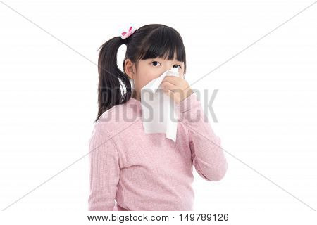 Beautiful Asian girl blows her nose on white background isolated