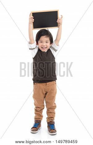 Cute asian boy holding black board on white background isolated