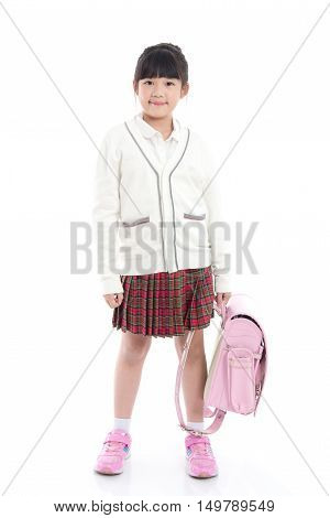 Asian child in school uniform with pink school bag on white background isolated
