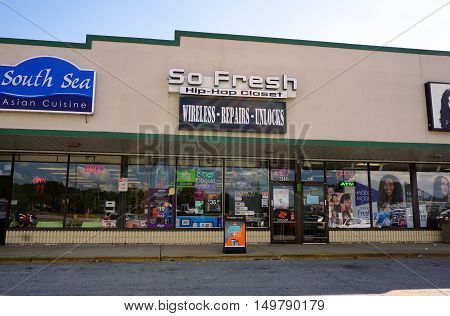 BOLINGBROOK, ILLINOIS / UNITED STATES - SEPTEMBER 17, 2016: One may purchase cellular telephones and other items at the So Fresh Hip Hop Closet in Bolingbrook's River Woods Plaza strip mall.