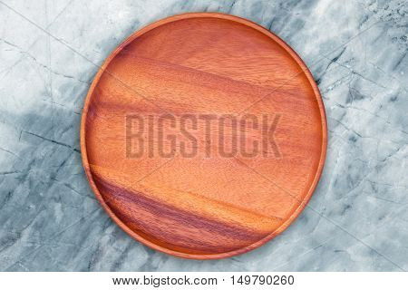 empty wood plate on marble table background / can be used display your product / Top view.
