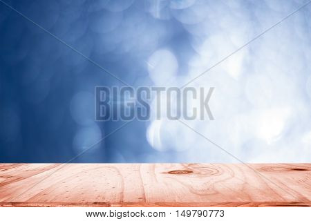 empty wood and dark blue blurred background / can be used display your product or art work