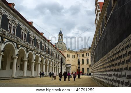 DRESDEN GERMANY - JULY 13 2015: the city center with historic buildings and the Fuerstenzug (Procession of Princes) a giant mural