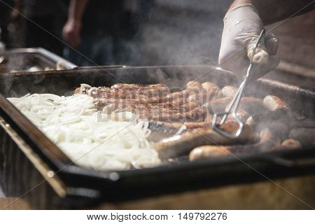Fresh German Sausages With Onions On Grill, Bratwurst