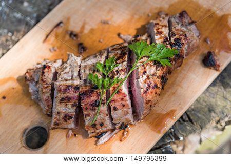 fried pork piece on wood table