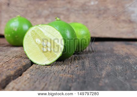 limes closeup Select focus with shallow depth of field on the wooden table