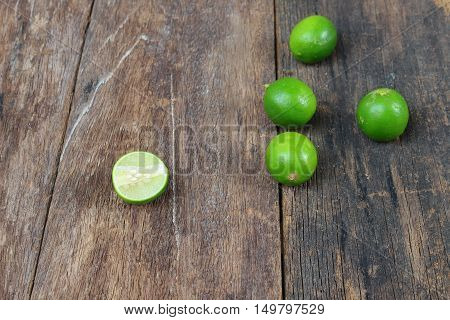 lemon fresh green and slice lime on wooden table top view