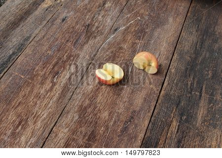 slice half red apple on wooden background top view with copy space.