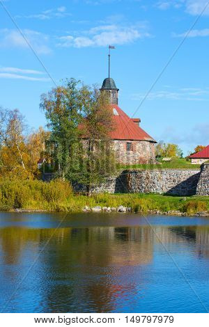 View of the old tower Lars Torstennsona, sunny october afternoon. Korela fortress. Priozersk, Russia poster