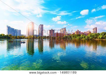 Scenic summer view of Dnieper river pier with modern skyscraper buildings in the Obolon District in Kiev, Ukraine