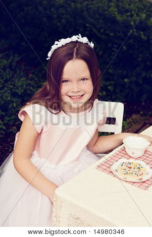 Little Girl Having Tea Party