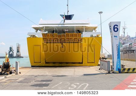 Piombino Italy - June 30 2015: Ferry boat Corsica Express opens its cargo hold at berth of seaport