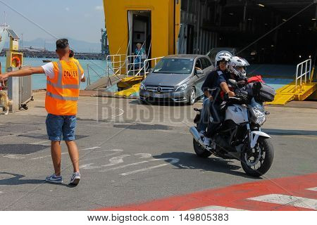 Piombino Italy - June 30 2015: Unloading passengers and vehicles from ferry boat Corsica Express in the seaport