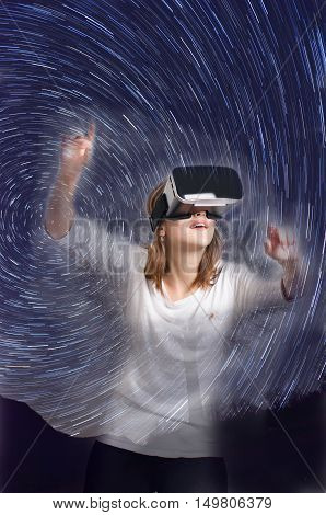 Double exposure. Woman with virtual reality goggles lie on a carpet. Studio Woman show a gesture.