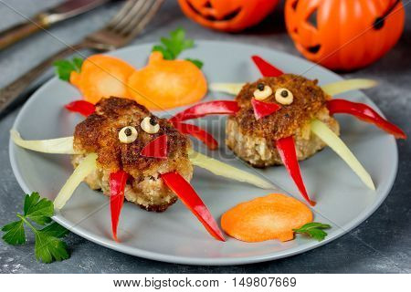 Creative food idea for kids - meatballs with colorful bell pepper shaped funny spider garnish pumpkin slice Halloween dinner recipe