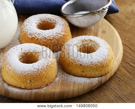 homemade donuts with powdered sugar on the table
