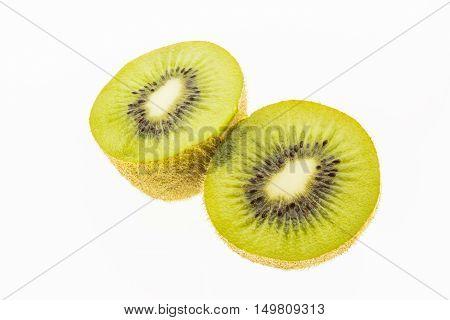Kiwi slices into half on white background