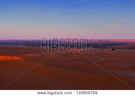 Sand dunes at sunrise in Erg Chebbi, Western Sahara, Morocco