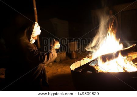 ERG CHEBBI, MOROCCO - JANUARY 5, 2014: Bedouin resting on camp site in Sahara Desert.