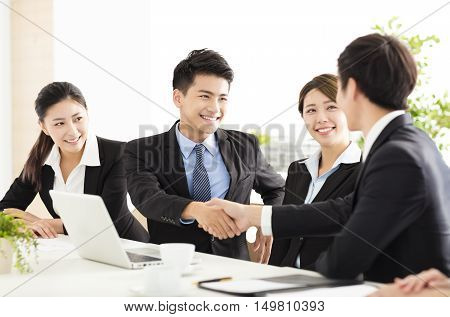 asian business people shaking hands during meeting