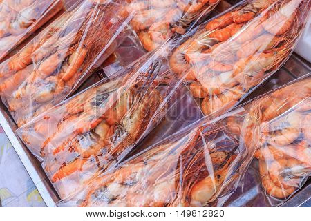 Streamed shrim in pastic bag ready for serving